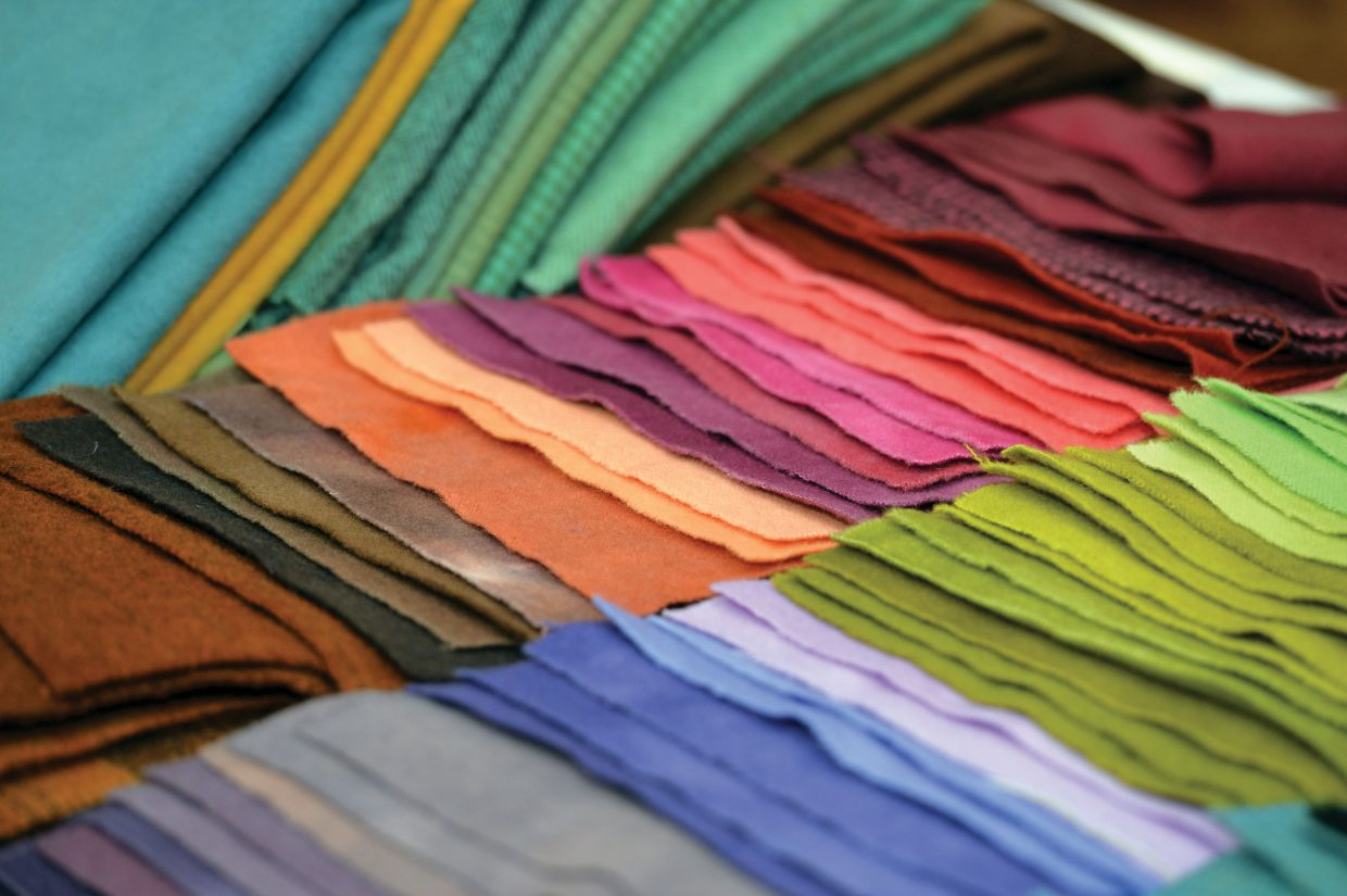 Swatches of material line a table at this year's Rocky Mountain Quilting Adventure.