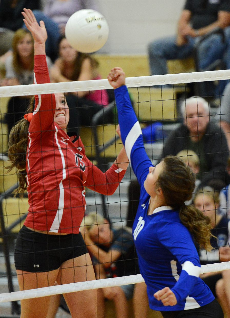 Steamboat's Jenna Miller and Moffat County's Charli Earl battle over a ball at the net Thursday as the Sailors and the Bulldogs clashed in an early season match in Steamboat Springs. Steamboat won in three sets, improving to 6-0.