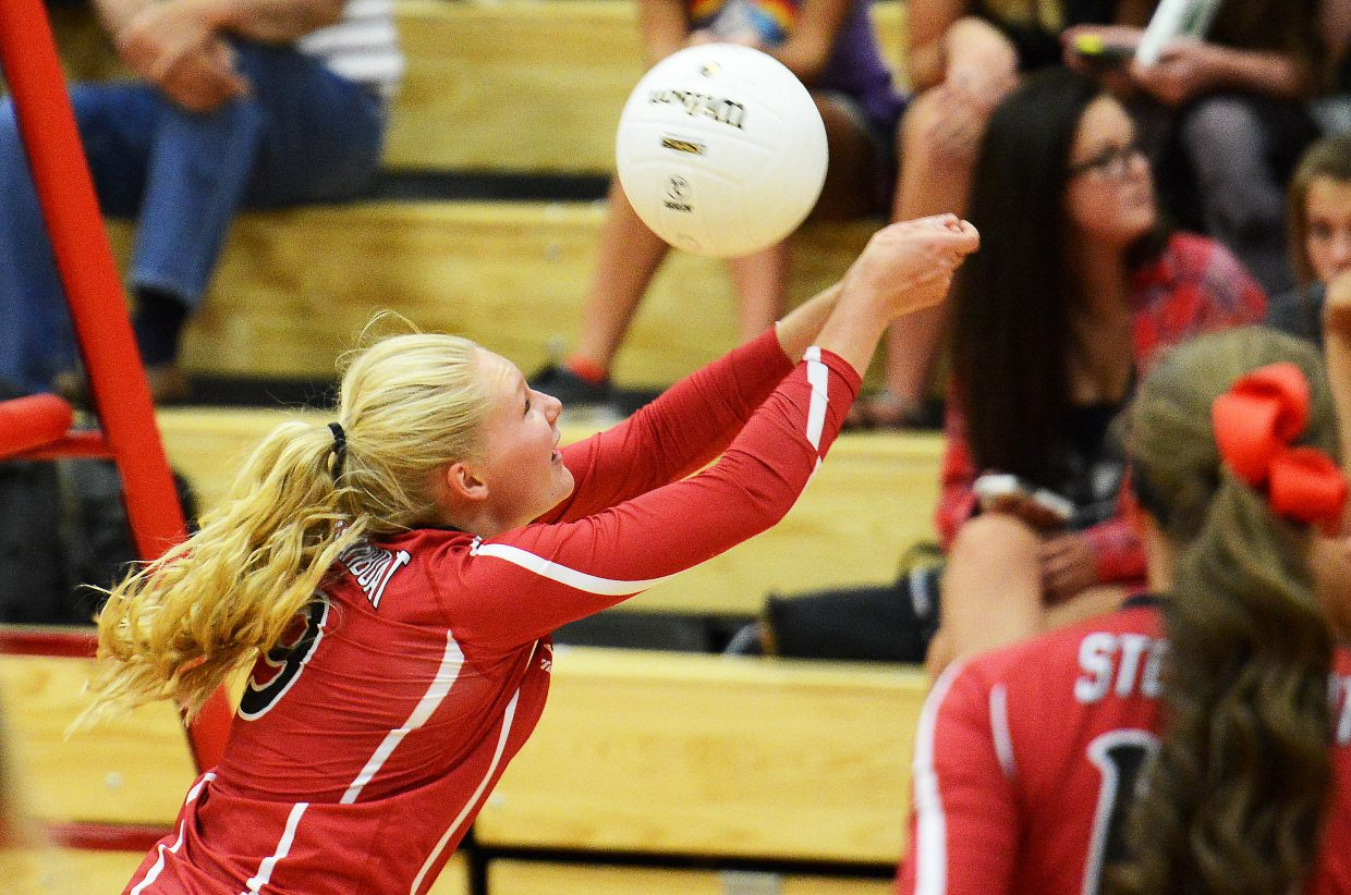 Abigail Wiedel reaches to save the ball Thursday as Steamboat battled Moffat County in volleyball.