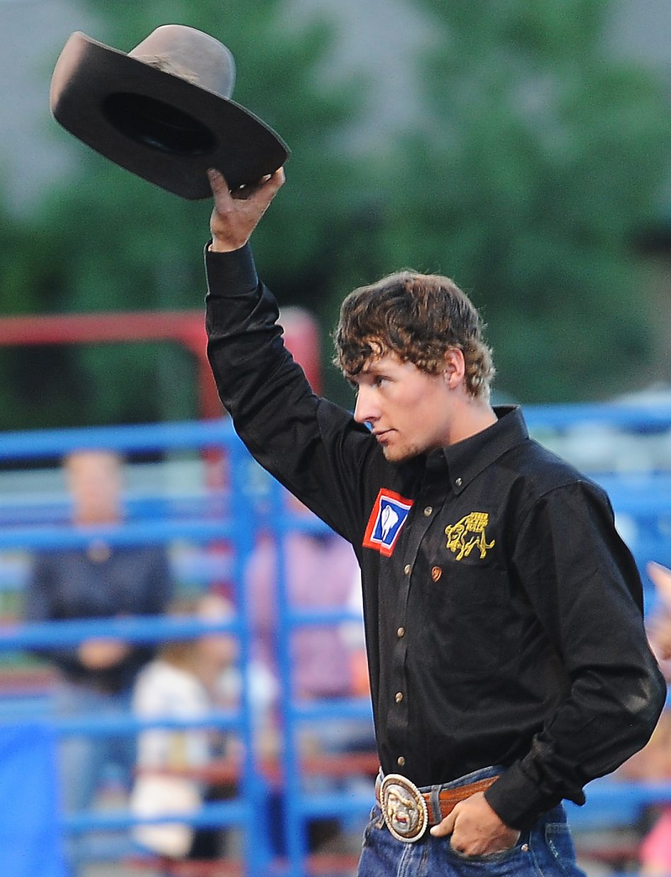 Hayden cowboy Kaiden Decker salutes the crowd after winning Sunday's Rocky Mountain Bull Bash bull riding competition in Steamboat Springs.