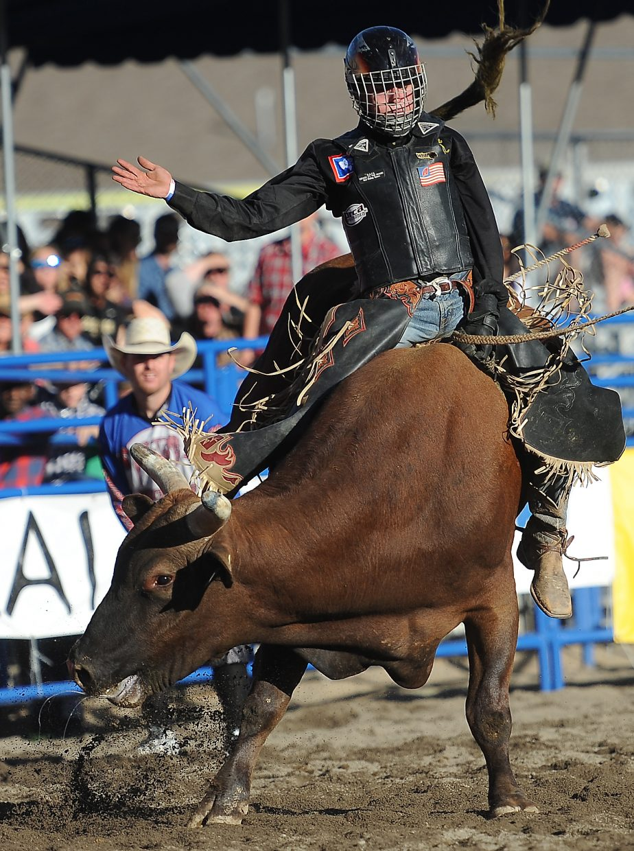 Hayden cowboy Kaiden Decker hangs on tight as Red Revolver spins him to an 81.5-point ride during the long round of Sunday's Rocky Mountain Bull Bash in Steamboat Springs. Decker went on to win the event.