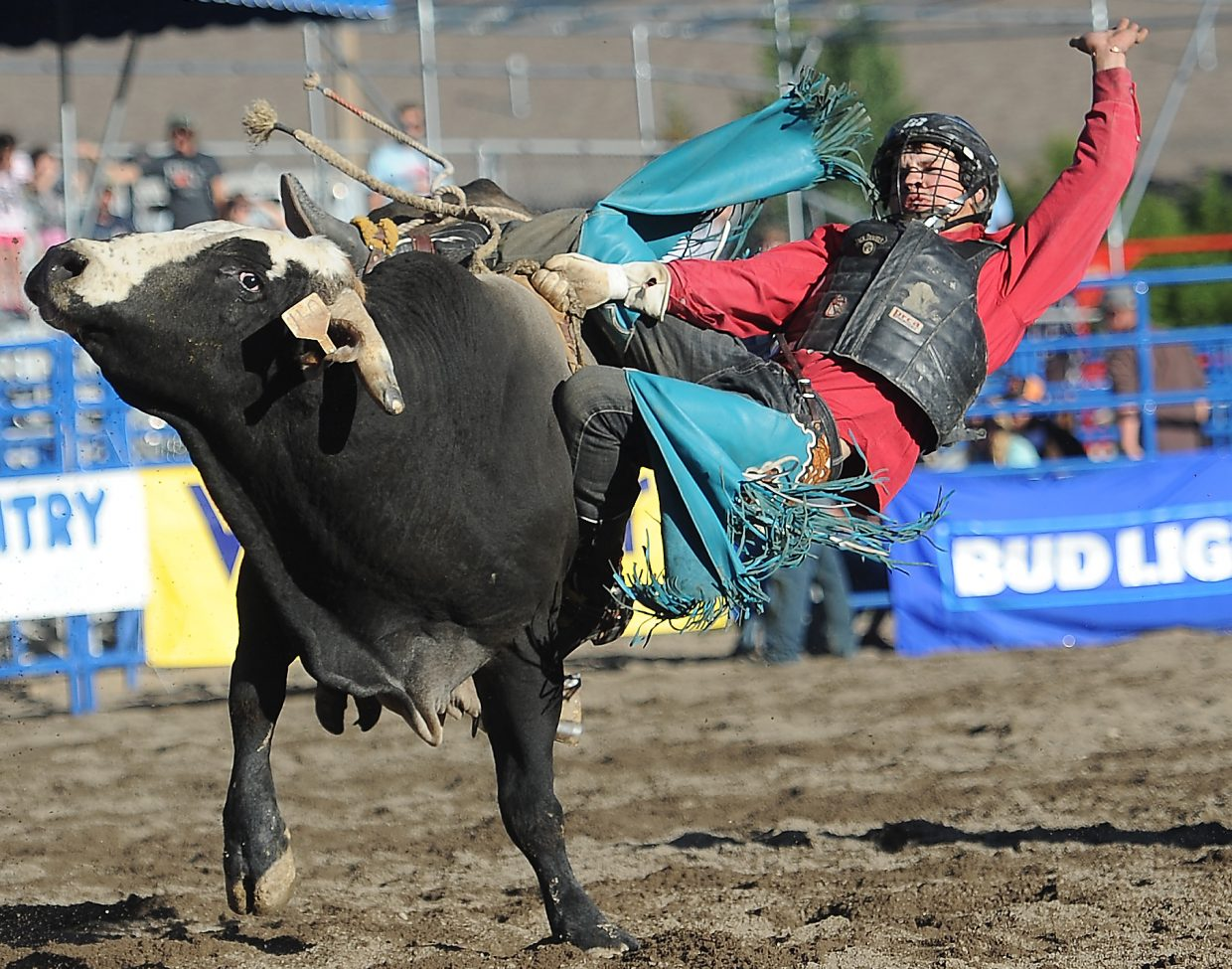 Tyrell Ward does his best to hang on as the bull Stingray spins him for a loop Sunday at the Rocky Mountain Bull Bash in Steamboat Springs.