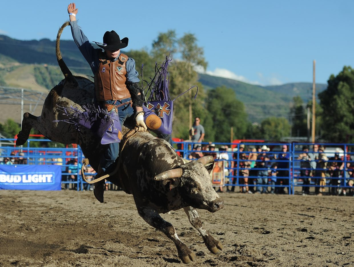 JC Mortensen rides high on his bull, Phil, Sunday during the Rocky Mountain Bull Bash in Steamboat Springs. Mortensen's Steamboat rodeo roots run deep. His father, Jed Mortensen, put on Sunday's event and his grandfather is legendary Steamboat bareback rider J.C. Trujillo.