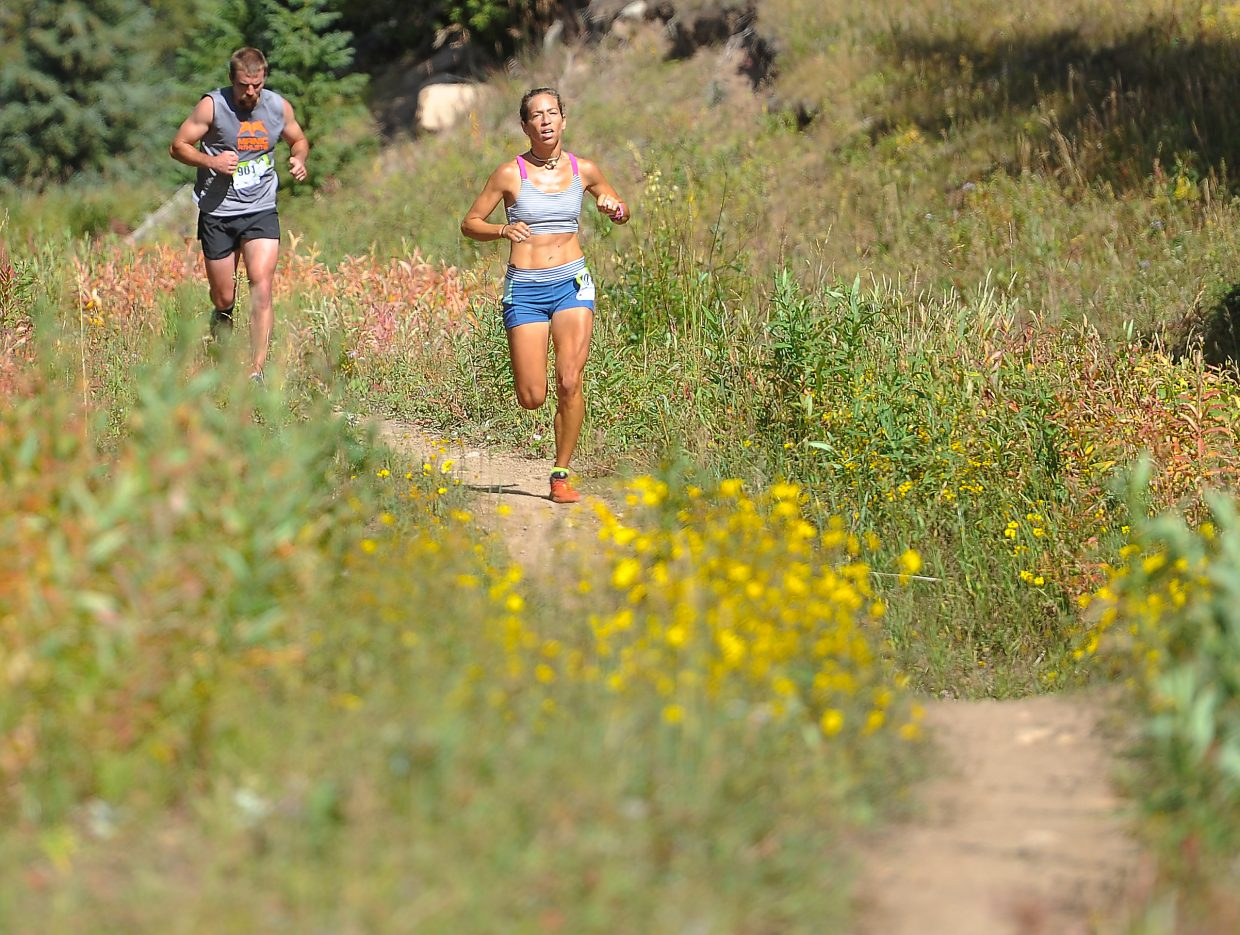 Penelope Freedman charges down the trail Sunday during the 10K at 10,000 on Rabbit Ears Pass.