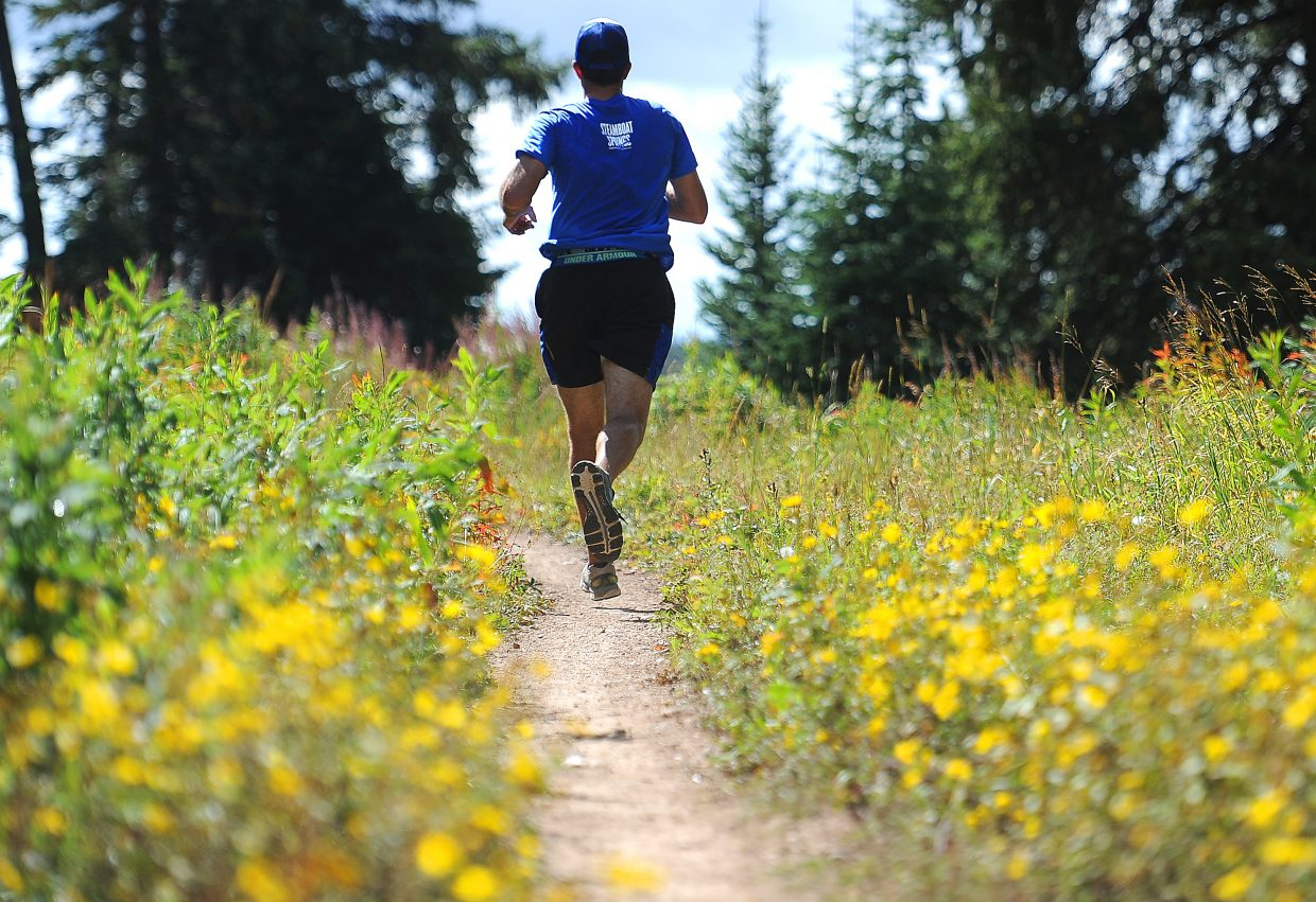 A runner heads through the early fall colors and toward the finish line Sunday during the 10K at 10,000 run on Rabbit Ears Pass.