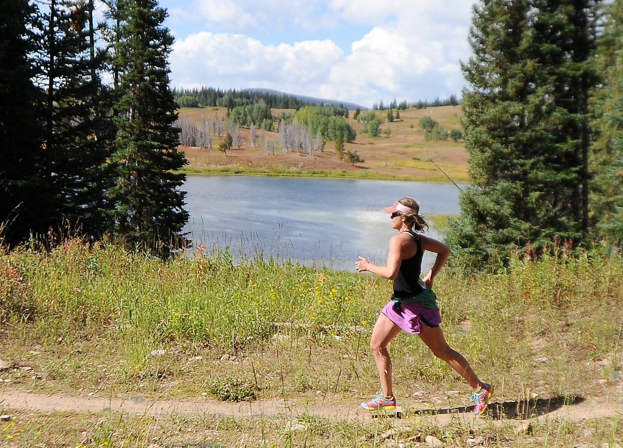 Michelle Stewart runs down the trail next to Dumont Lake on Sunday during the 10K at 10,000 on Rabbit Ears Pass.