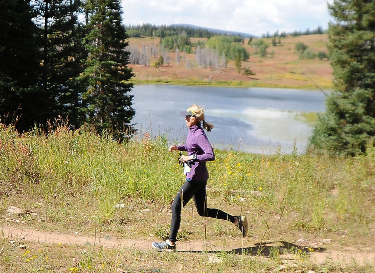 Marietta Roberts runs alongside Dumont Lake on Sunday during the 10K at 10,000 trail running race on Rabbit Ears Pass.