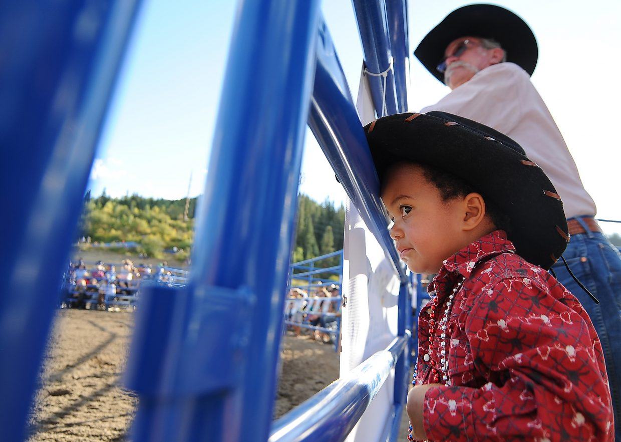 Bulls eyeing: Benji Simbeye, 3-year old and aspiring cowboy, looks in at the rodeo arena Sunday during the Rocky Mountain Bull Bash in Steamboat Springs. The event drew packed stands for an evening of bull riding, a Labor Day weekend tradition in Steamboat Springs.