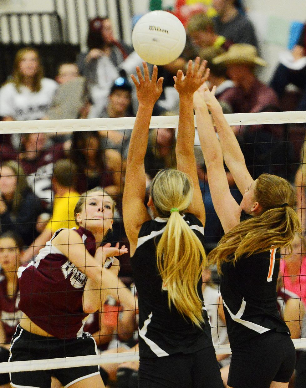 Soroco's Kali Constine hits into a pair of Hayden defenders Friday.