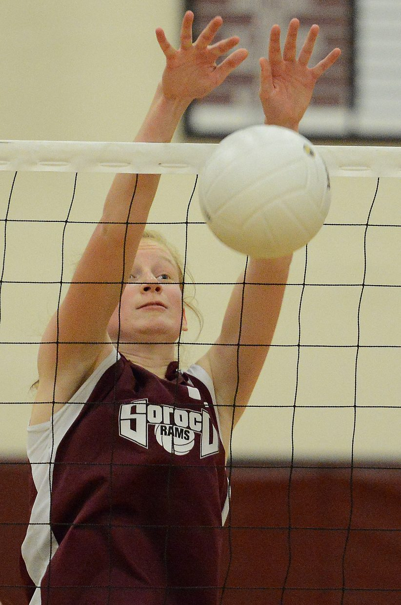 Soroco's Lucy Carlson blocks a ball Friday against Hayden.