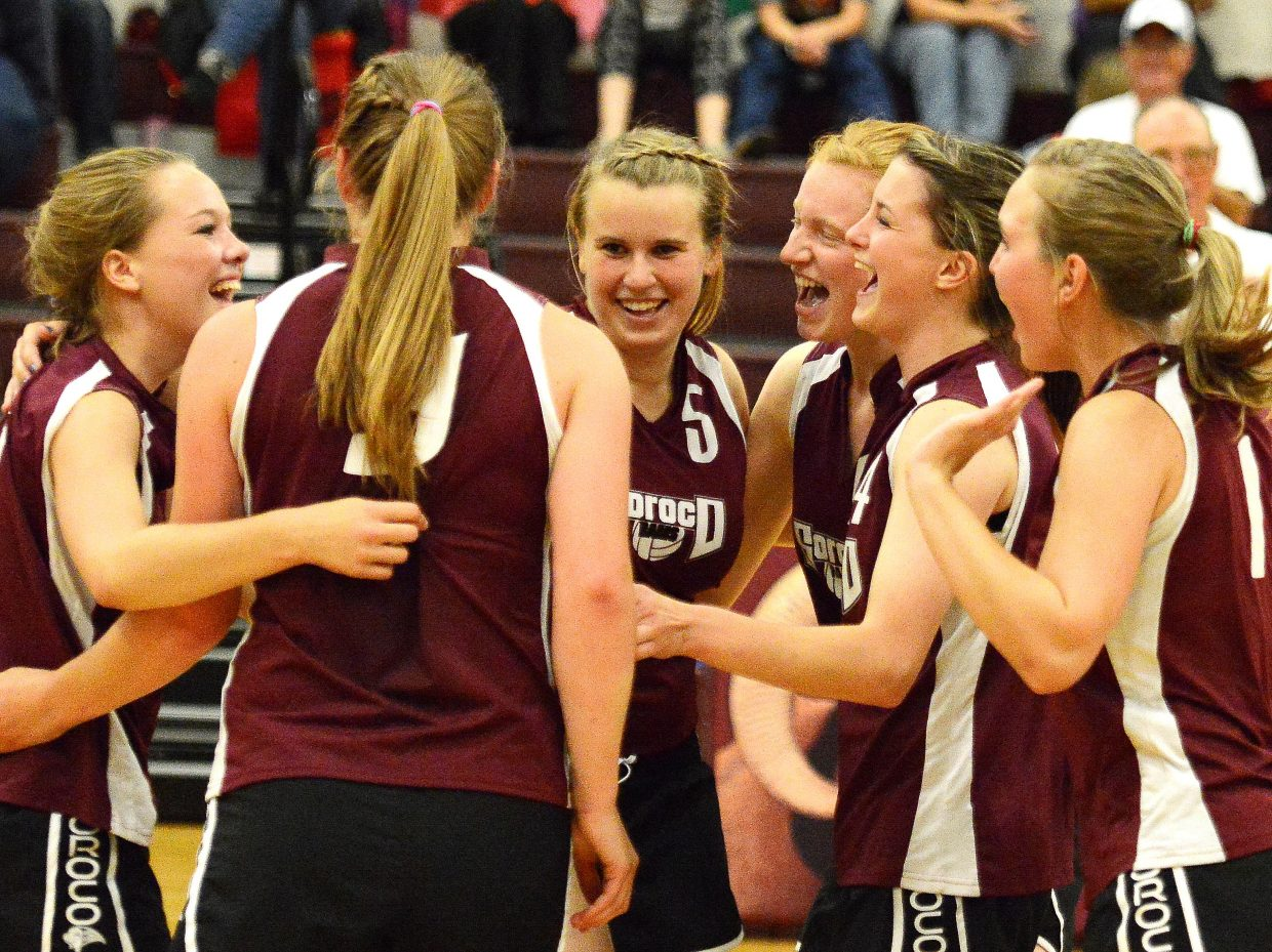 The Soroco High School volleyball team celebrates after the final point in Friday's match against Hayden.