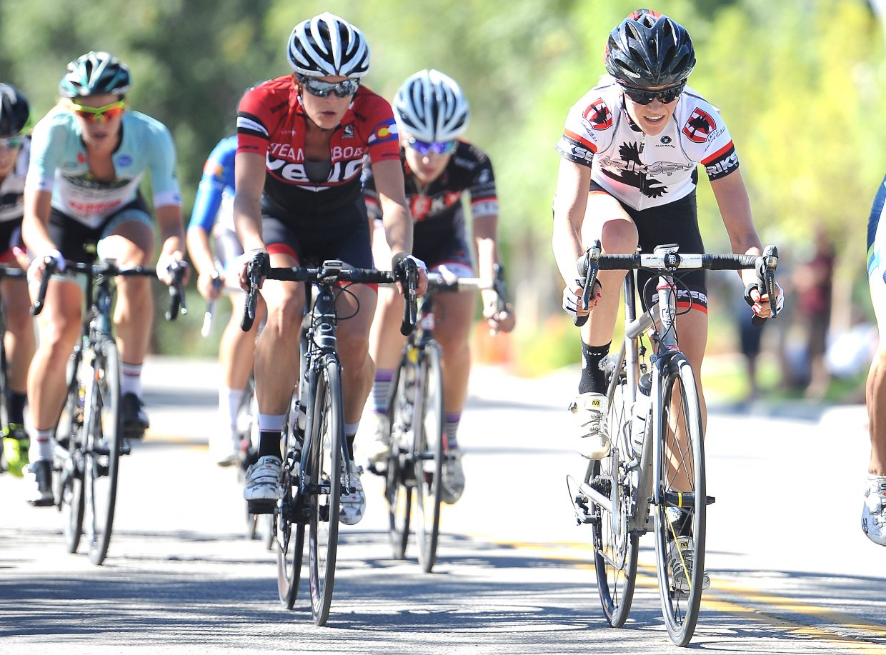 Susie Jones, left, and Hannah Williams ride together late in the women's criterium race during the third stage of the Steamboat Stage Race. Williams went on to win her division, while Jones was fourth in hers.