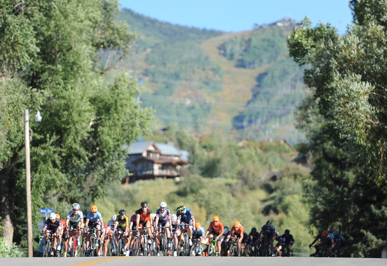 The men's pro field works its way up Pine Street on Monday at the Steamboat Stage Race in downtown Steamboat Springs.
