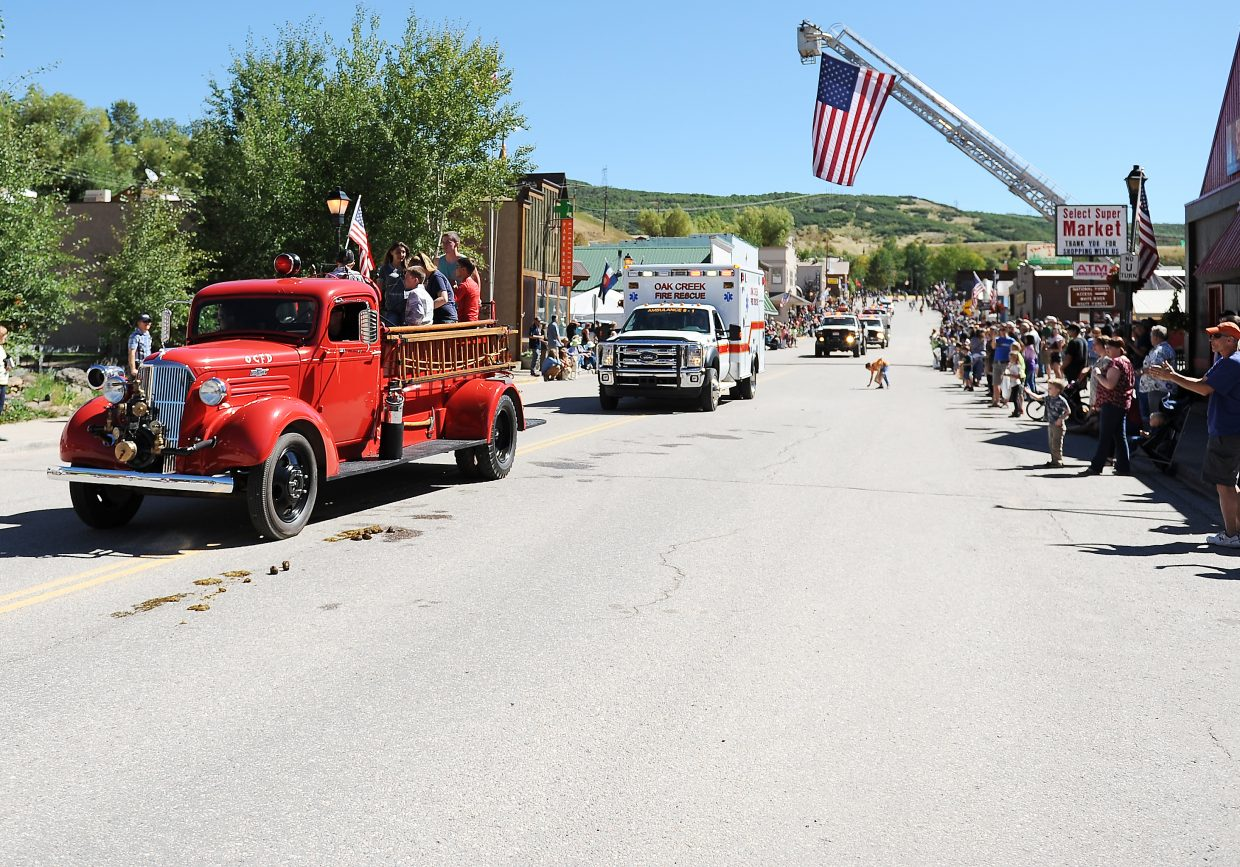 An old Oak Creek fire engine makes its way down Main Street in Oak Creek on Monday during the town's annual Labor Day parade.