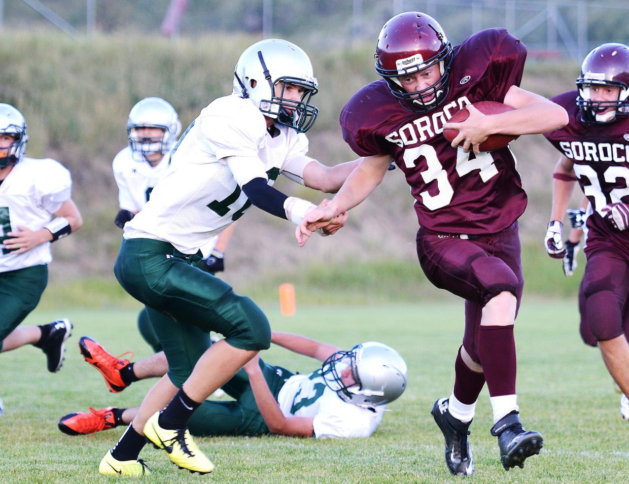 Soroco quarterback Warren Hayes rumbles for a first down Saturday as the Rams beat up Plateau Valley for a 44-22 win.