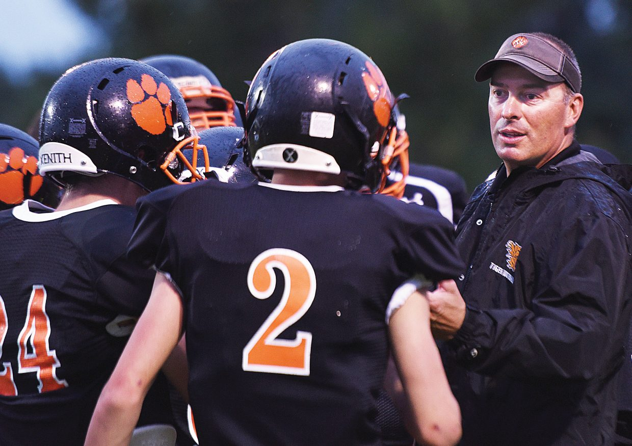 Hayden head coach Ryan Wilkie rallies his troops in the second half of the Tigers 12-6 victory over Nederland on Aug. 26. The Tigers are hoping to make it back-to-back wins this Friday when the team hosts Justice.