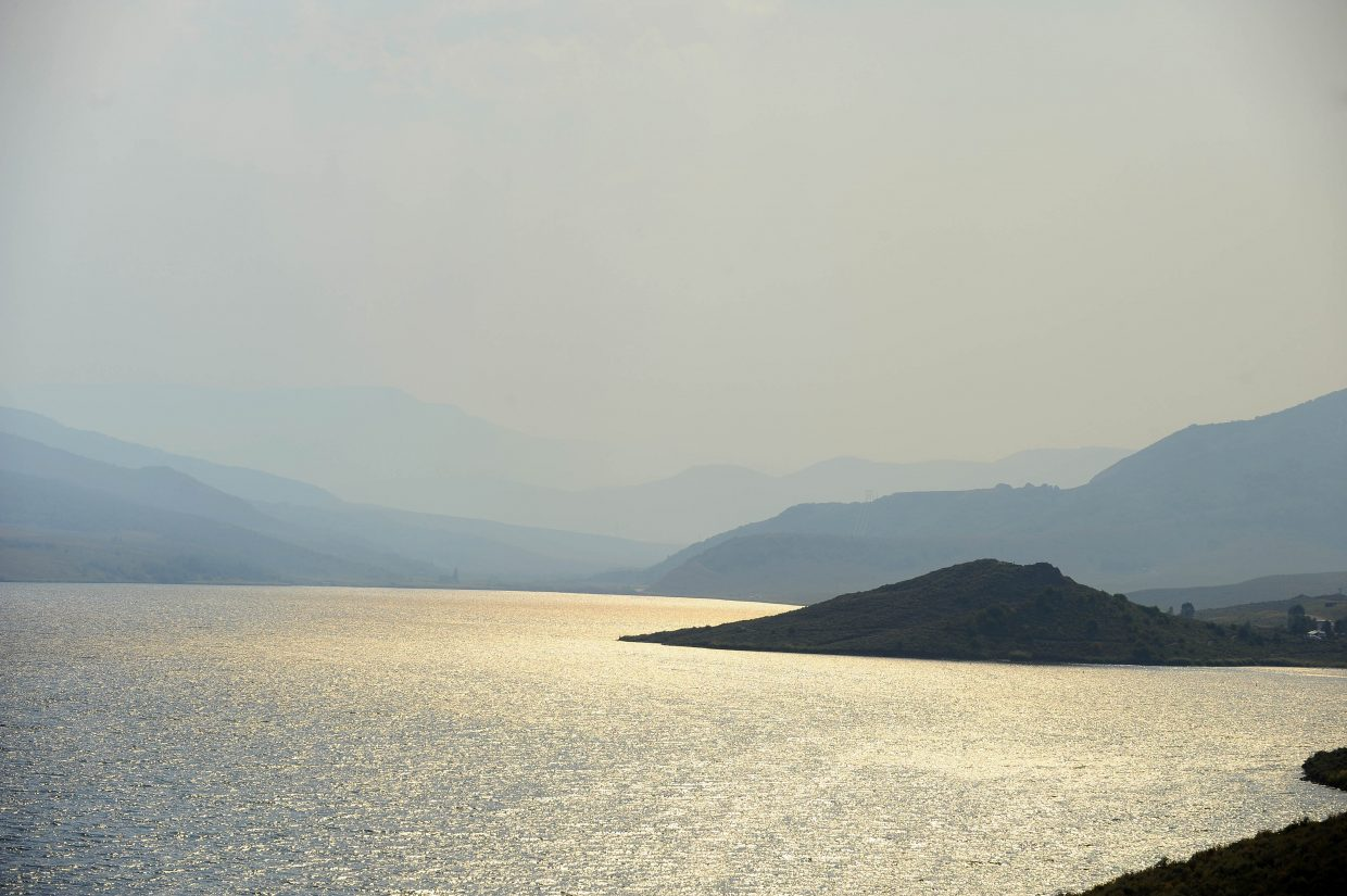 Smoke from the Lost Solar fire drifts over Stagecoach Reservoir on Tuesday.