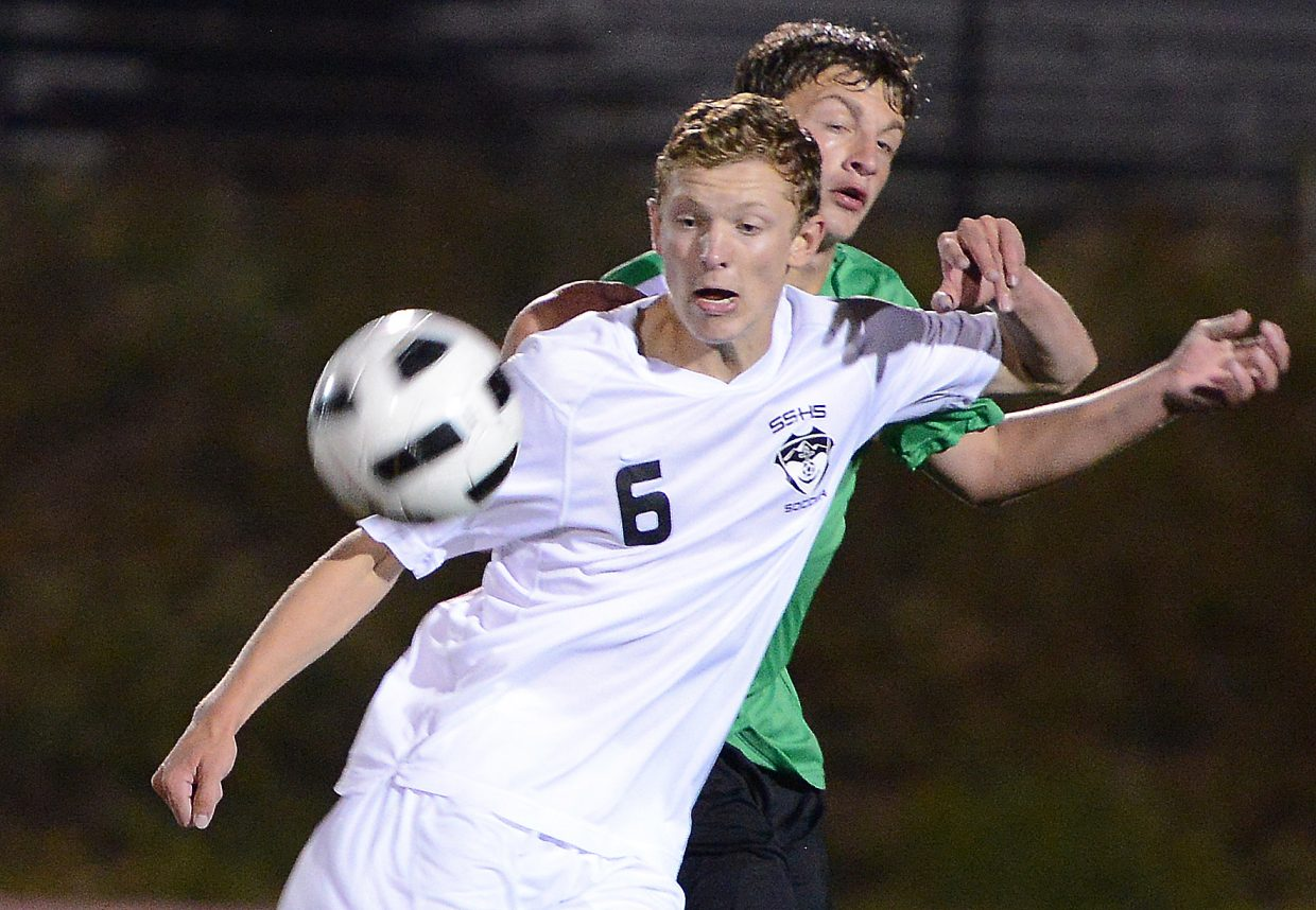 Charlie Beurskens fights for a loose ball Tuesday against Summit.