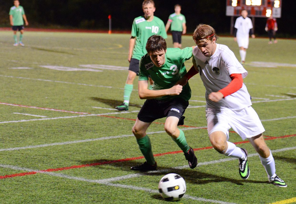 Steamboat's Nathan DePuy and Summit's Ed Bouchard fight for a ball late in Tuesday's game, which ended in a 2-2 draw.