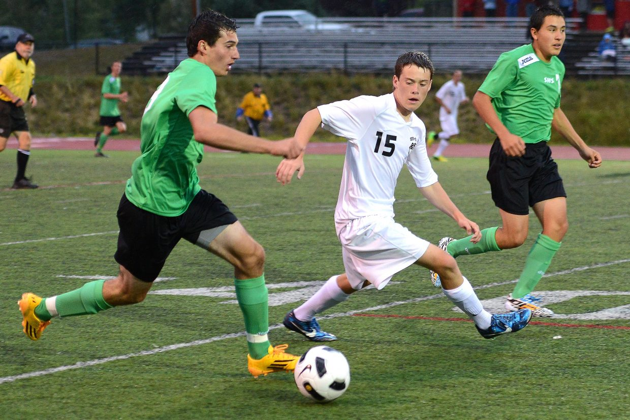 Steamboat's Jack Salyer tries to track down the ball Tuesday against Summit.