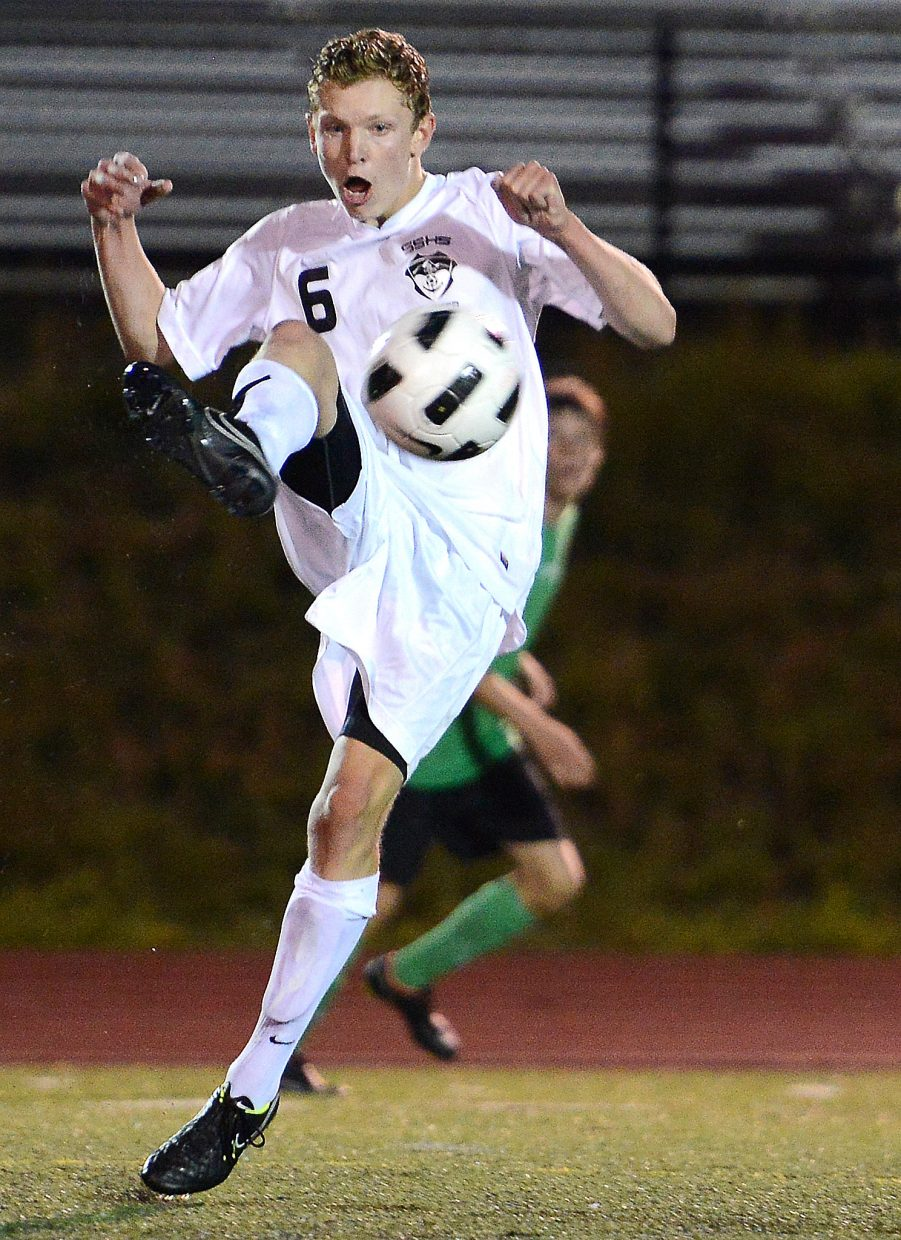 Charlie Beurskens gets high to bring down a ball Tuesday against Summit.