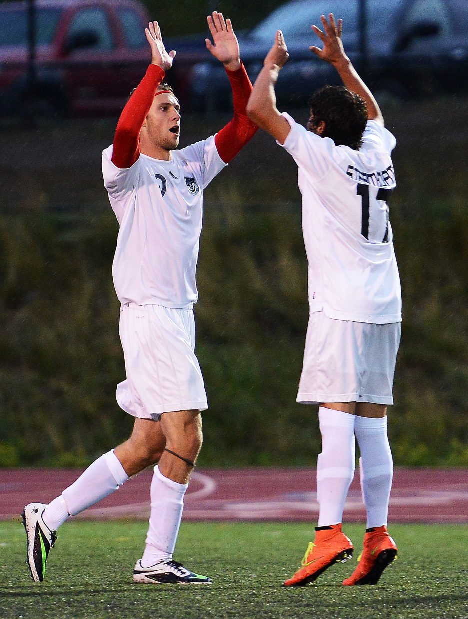 Steamboat's Nathan DePuy and Cruz Archuleta celebrate a goal Tuesday against Summit.