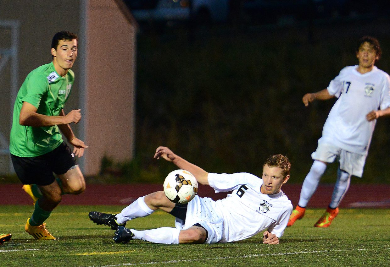 Charlie Beurskens gets low on defense Tuesday against Summit.