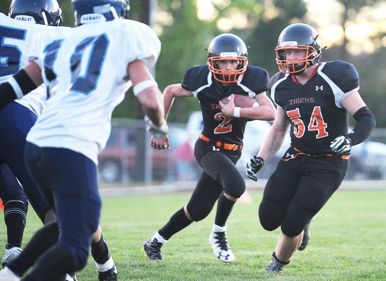 Hayden's Garrett St. Clair rushes behind his blockers Friday against Justice.