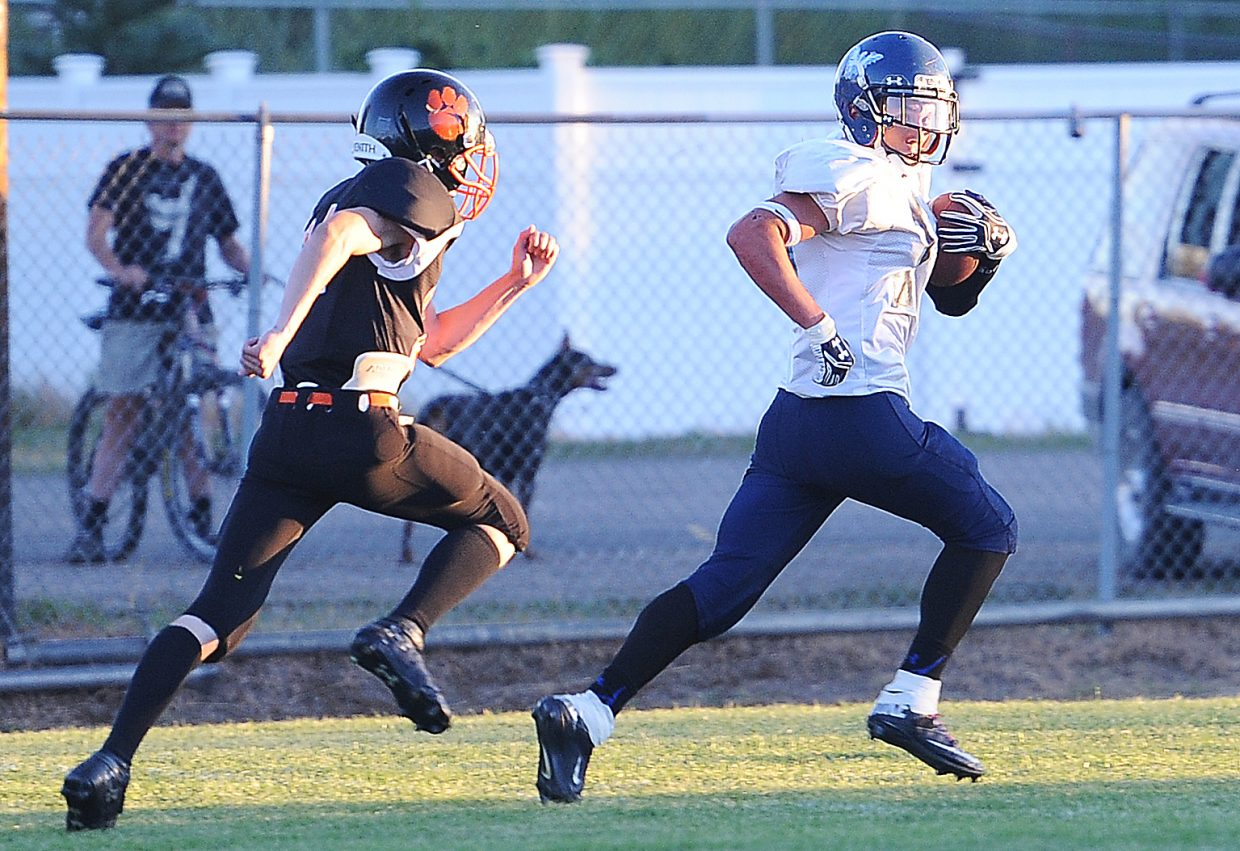 Justice wide receiver Justin Hunyadi runs for a touchdown Friday against Hayden.