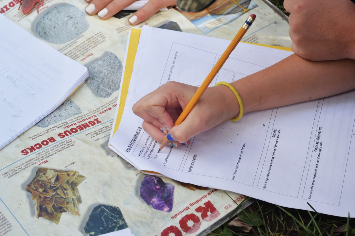 A student fills out her journal at the Yampa Valley Science School on Wednesday afternoon at the Perry-Mansfield Performing Arts School and Camp near Steamboat Springs. The camp will host students from Steamboat Springs, Emerald Mountain, South Routt and North Routt in the next few weeks.