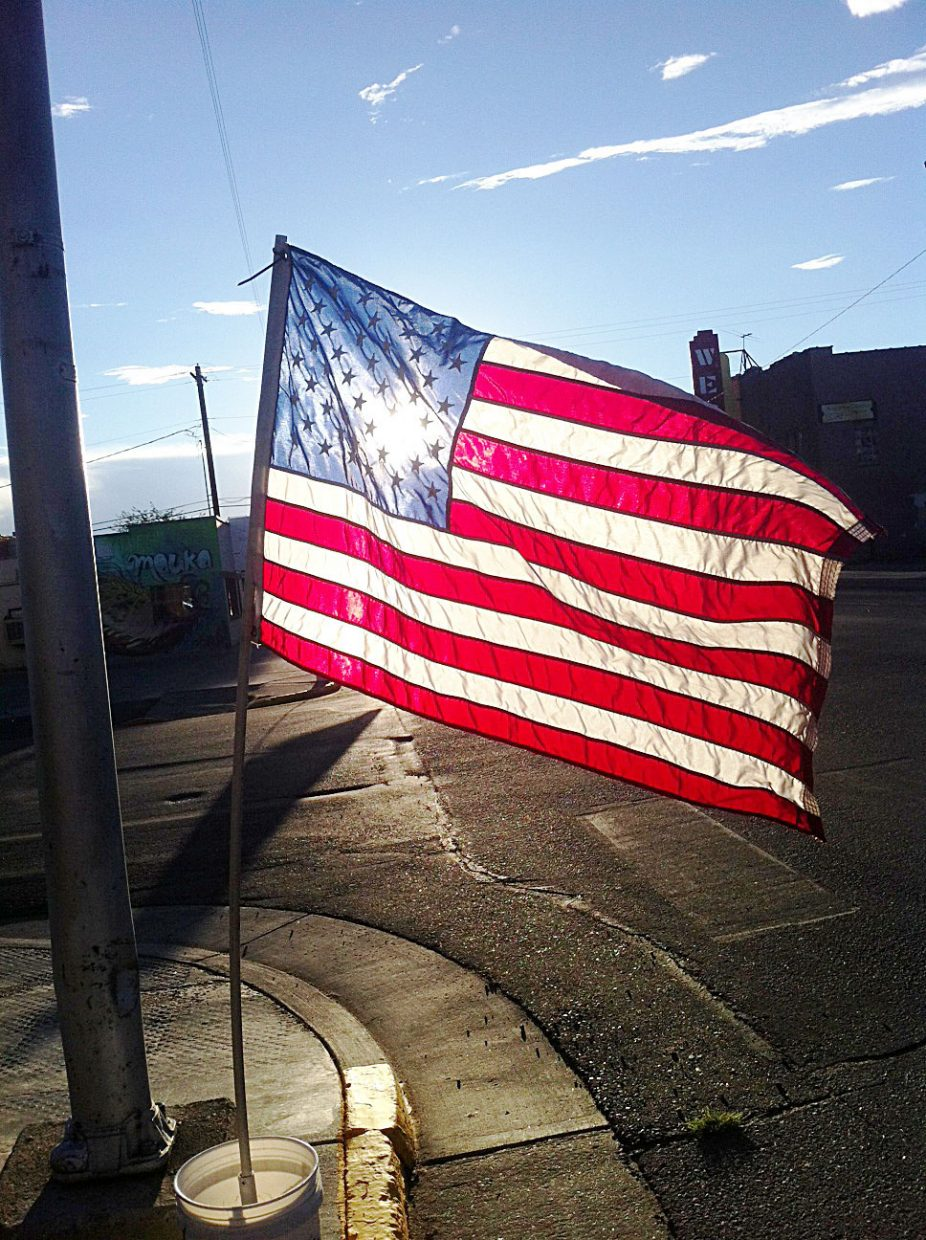 The sun shines through the American flag along Victory Way in Craig. Flags lined the street Thursday in honor of Sept. 11.