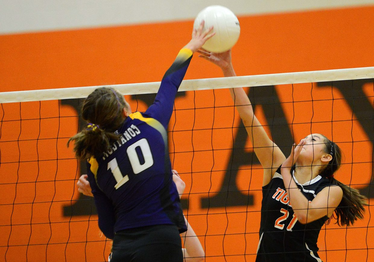 Hayden's Brooke Munden fights for a ball at the net Thursday.