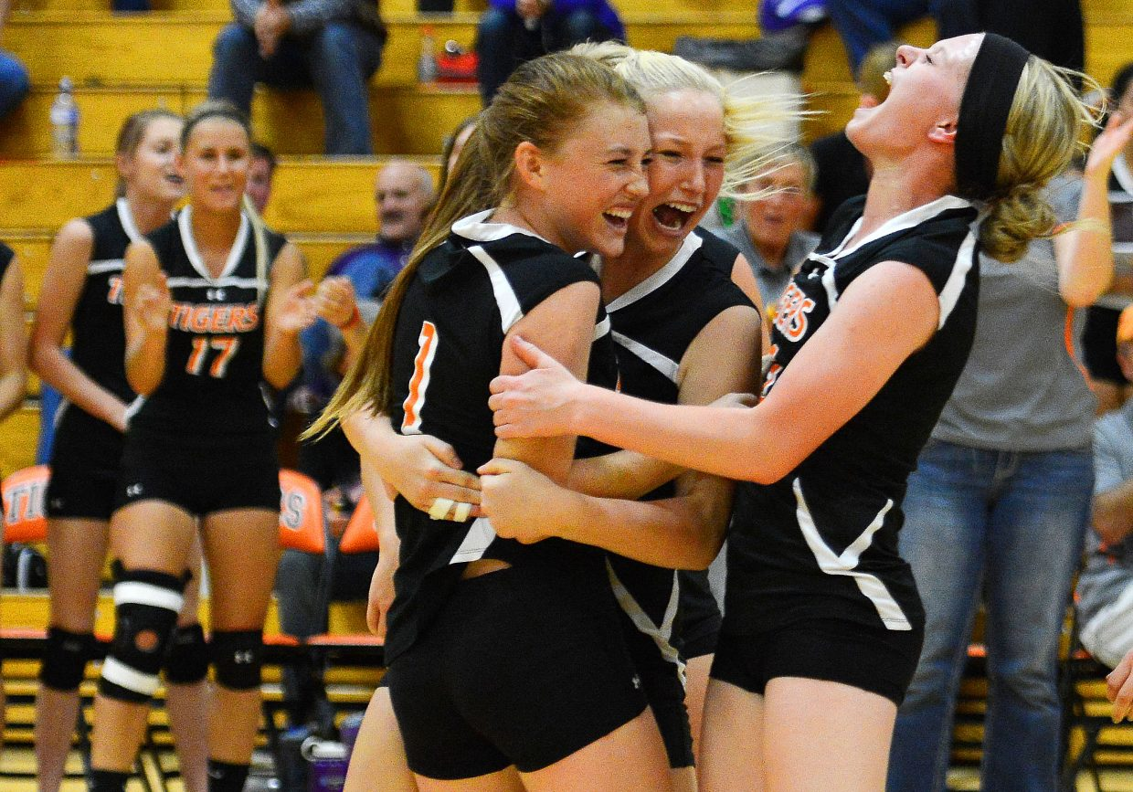 Hayden volleyball players Darian Murphy, Kenzie Fry and Grace Wilkie celebrate after the Tigers beat West Grand on Thursday in five thrilling sets. The win was Hayden's first of the season.