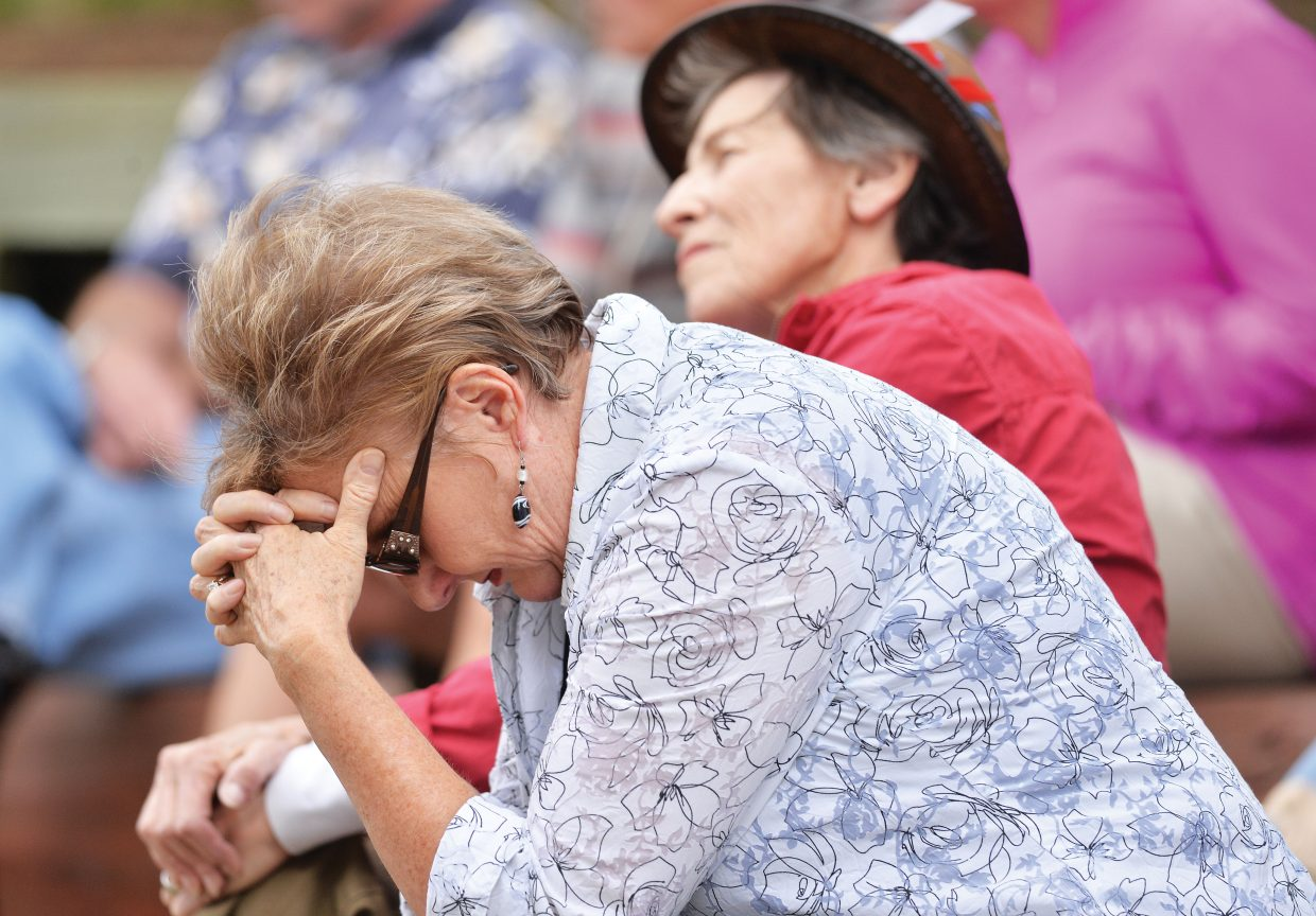 Thirteen years after the Sept. 11 attacks, many people, including Judy Strnad, still grapple with their emotions as they remember the events of that day. On Thursday evening, many people gathered at the Yampa River Botanic Park amphitheater for 15 minutes in memory of those who died on 9/11. The 15-minute ceremony included music but no words.