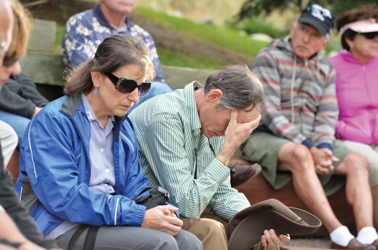 Mary Ann, front, and Perry Ninger reflect on the events of Sept. 11, 2001, during a ceremony at the Yampa River Botanic Park amphitheater Thursday evening. The event marked the day terrorists attacked the United States, crashing passenger planes into the the World Trade Center and the Pentagon. Terrorists also hijacked United Airlines Flight 93, which crashed in a field in Pennsylvania after passengers attempted to regain control of the plane in midflight. The crash killed all 44 people on board, including the four hijackers.