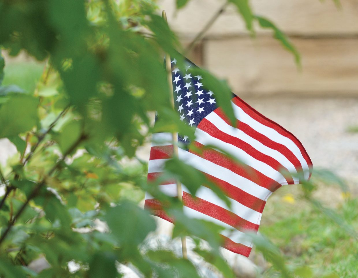 An American flag blows in the breeze Thursday evening, marking the 13th anniversary of the Sept. 11 attacks.