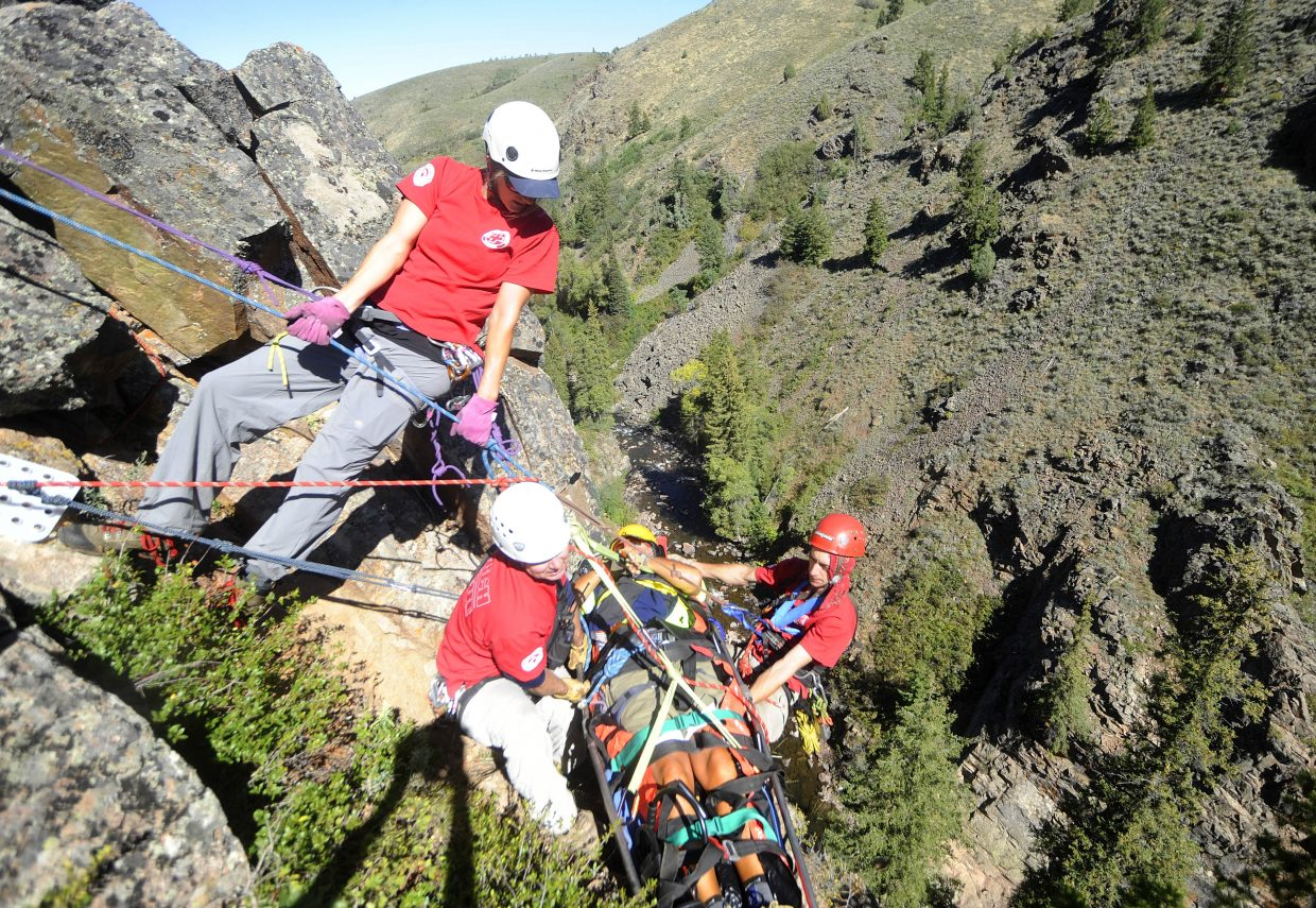 Routt County Search and Rescue members, from left, Rory Clow, Russ Sanford and Dalton Reed, bring up their mock patient, Ty Upson, above King Solomon Falls during a Sept. 6 training exercise.