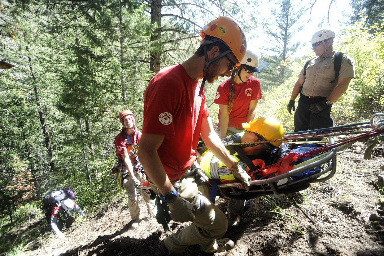 Routt County Search and Rescue members, from left, Dalton Reed, Dusty Atkinson and Rory Clow bring up their mock patient, Ty Upson. Also pictured is Colorado Parks and Wildlife ranger Robert Seel.