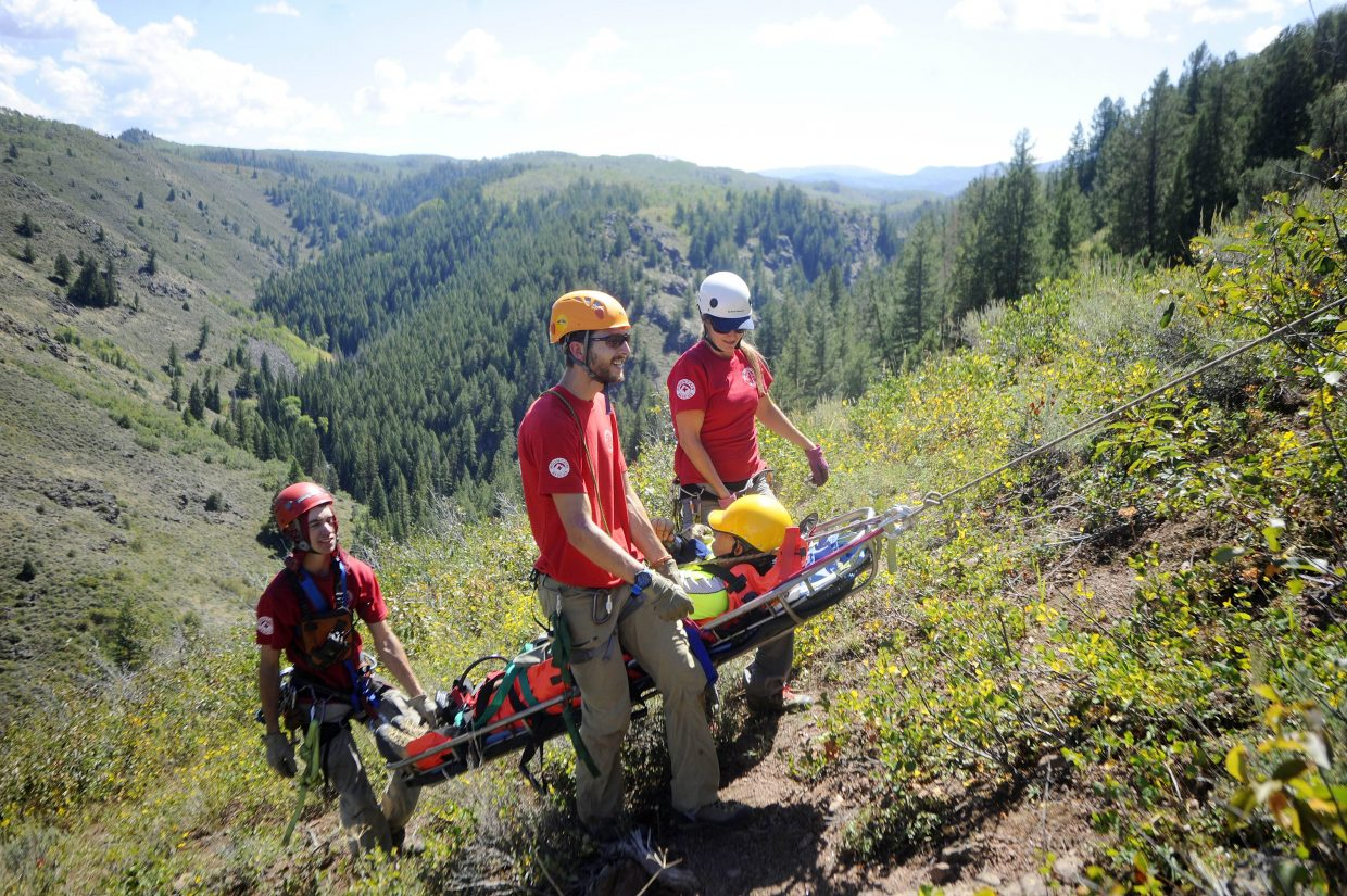 Routt County Search and Rescue members Dalton Reed, Dusty Atkinson and Rory Clow bring up a mock patient during a training exercise in 2014.