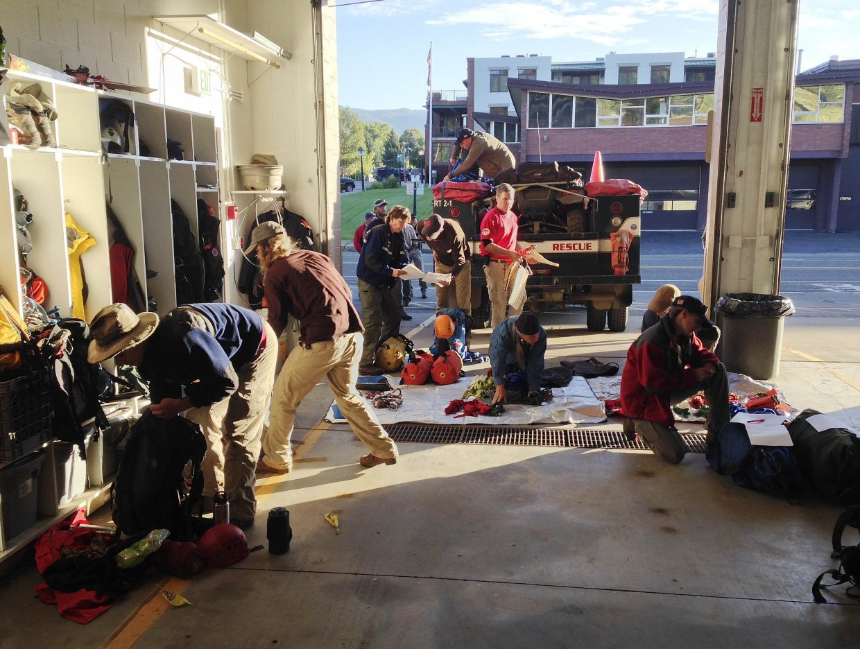 Routt County Search and Rescue volunteers gather gear for their training exercise.