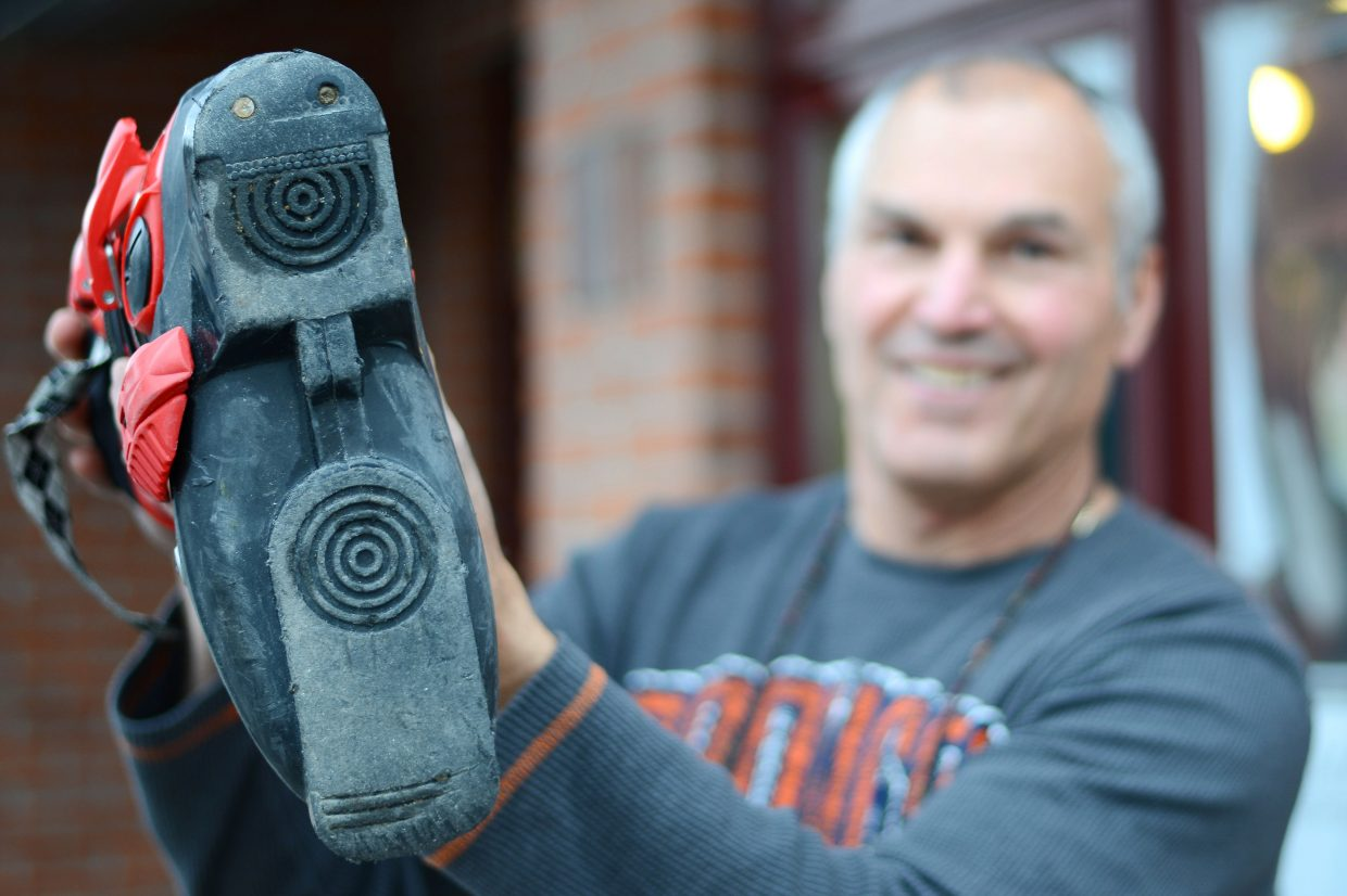 One Stop Ski Shop owner John Kole shows off a boot that needs some pre-season prep. Worn out soles are just one area where ski equipment may need some work before the local season starts.