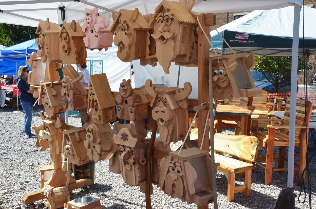 A variety of homemade birdhouses are on display during Saturday's Art'n the Park'n Lot. The event featured many forms of arts and crafts, including jewelry, ceramics, woodworking and more.