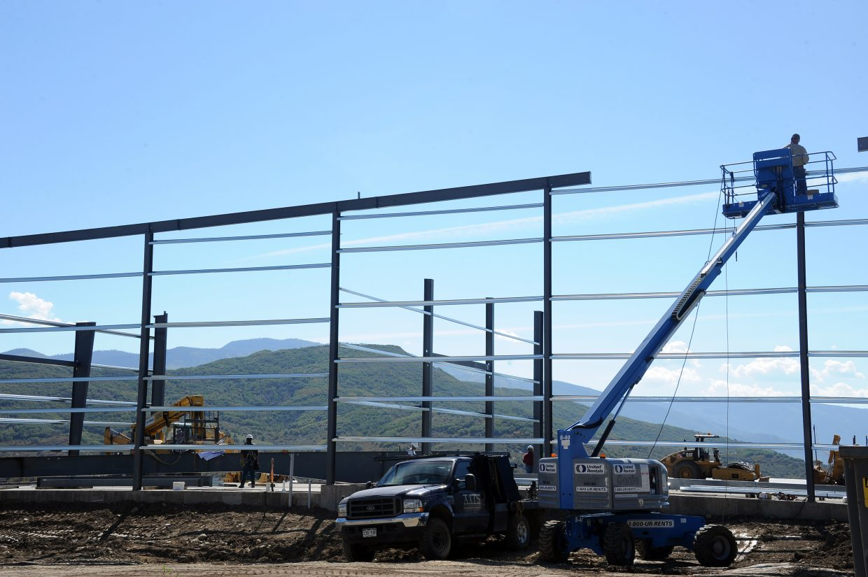 Construction crews work to build one of the new executive hangars at Steamboat Springs Airport on Tuesday. The hangars range in cost from about $500,000 to $650,000.