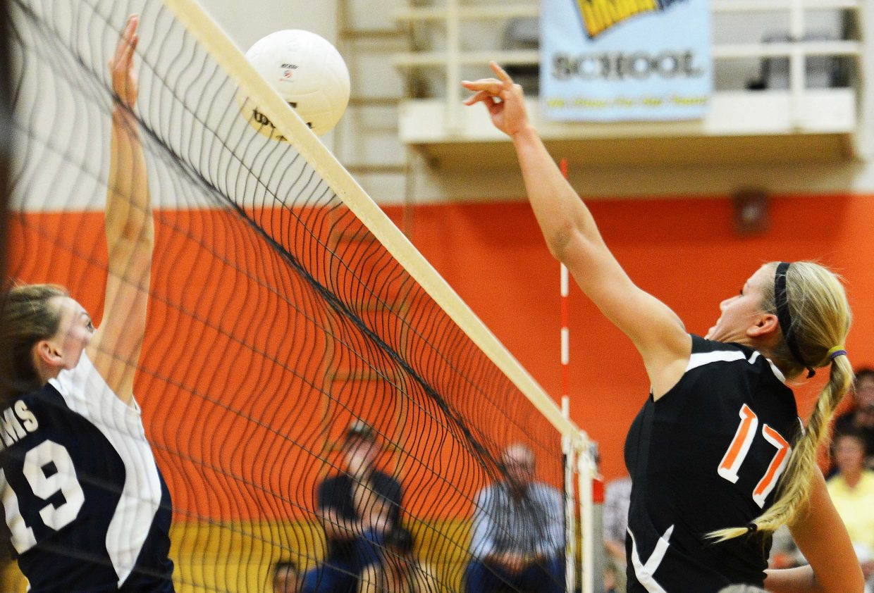 Hayden junior Jewel Vreeman taps the ball over the net Tuesday against Vail Mountain. The Tigers won the match in three sets, 25-15, 25-22, 25-18.