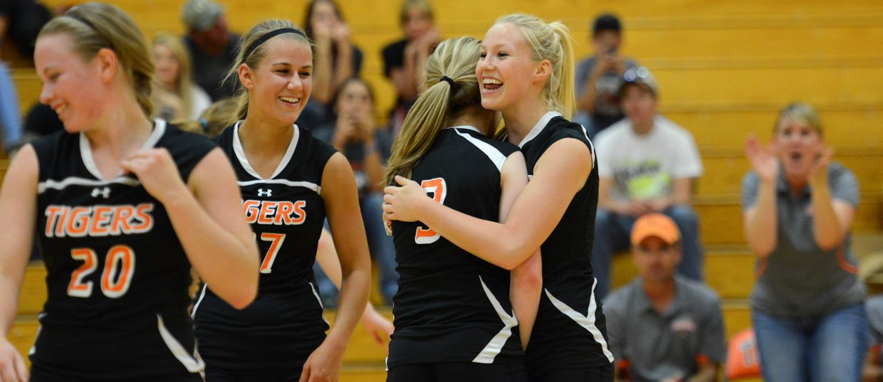 The Tigers celebrate a point in Tuesday's win against Vail Mountain.