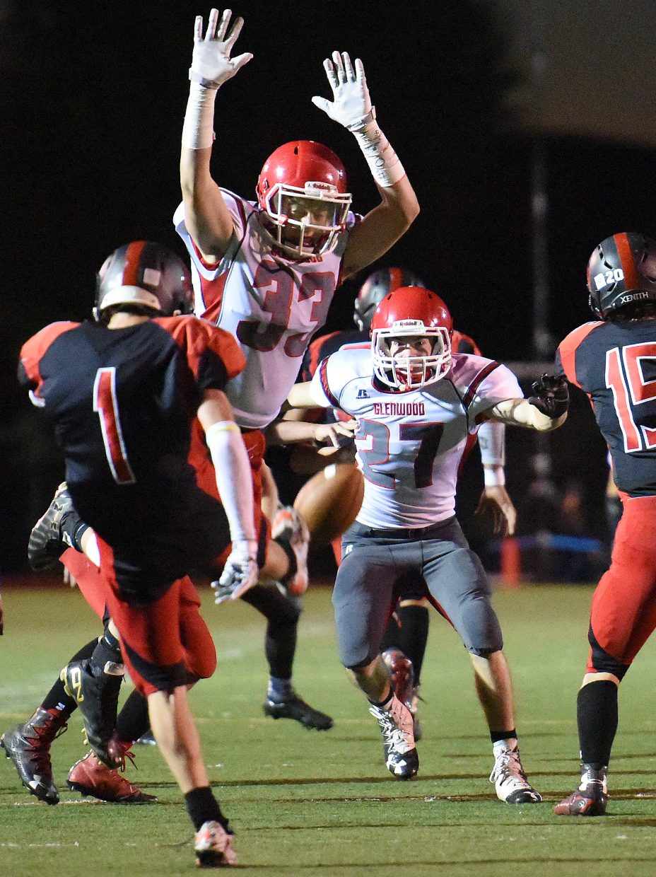 Glenwood Springs junior Jake Brown flies at Steamboat Springs punter Canon Reece Friday, leaping in for a block. Glenwood's Erwin Rodriguez scooped up the punt and ran it in for a touchdown, helping pave the way for the Demon's 48-7 victory against the Sailors.
