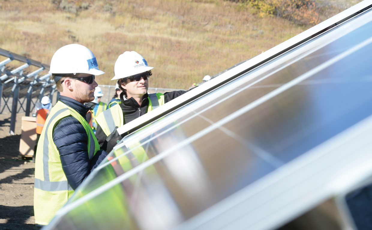 Volunteer Harry Jefferies works with Tim Cunningham while helping build a new community solar array near Yampa Valley Electric Association headquarters on Routt County Road 129. The volunteers joined YVEA employees building the array.