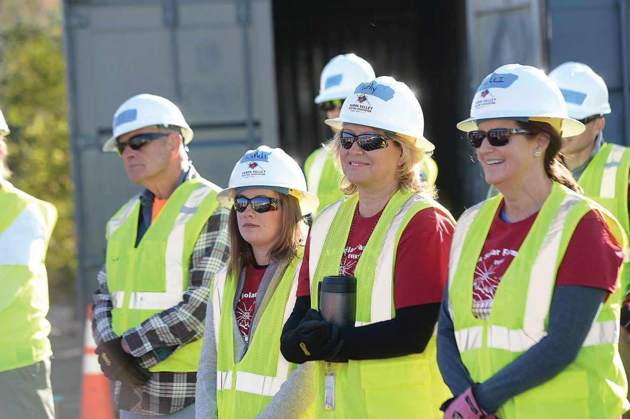 Employee volunteers from Yampa Valley Electric Association line up to help build a new solar array at the company's headquarters off of Routt County Road 192 Friday morning.