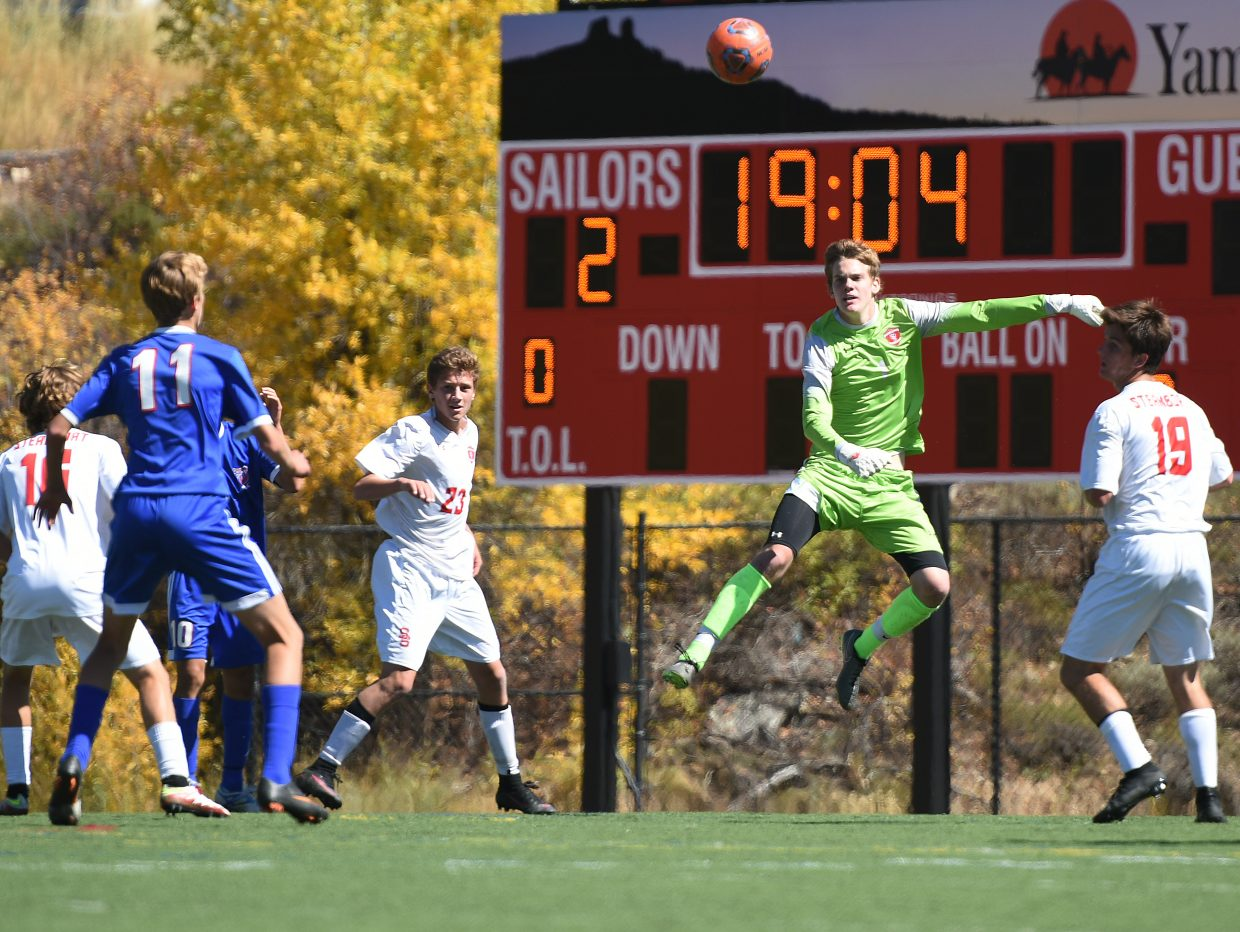 Steamboat Springs goalie Andrew McCawley flies high to track down a ball Saturday as the Sailors got a 2-1 win at home against Centaurus.