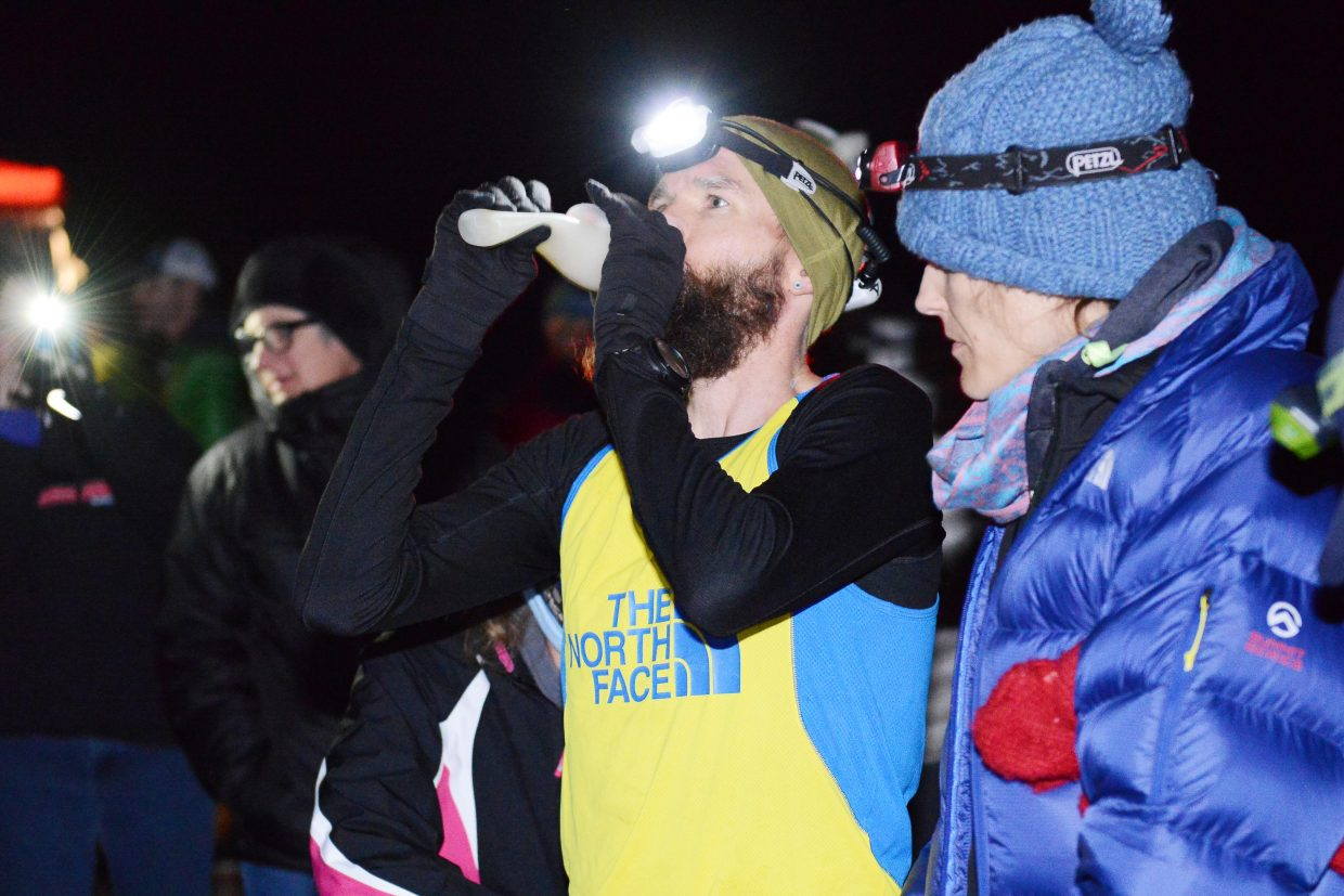 Run, Rabbit Run 100-mile champion Rob Krar re-hydrates at the 70-mile point of Steamboat Springs trail ultramarathon.